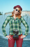 Hipster woman in hat and glasses with retro camera Stock Photography