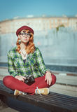 Hipster woman in hat and glasses with retro camera Stock Photos