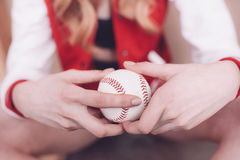Hipster woman holding baseball ball in hands Stock Photos