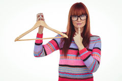 Hipster woman holding clothes hanger Royalty Free Stock Images