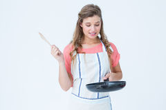 Hipster woman holding frying pan. On white background Stock Photography