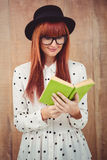 Hipster woman reading a green book Stock Images