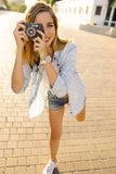 Hipster woman with retro film camera stock photo