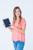 Hipster woman showing tablet pc Stock Photo