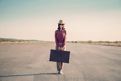 Hipster woman stands on road Royalty Free Stock Photo