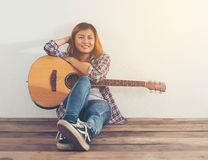 Hipster woman style portrait chilling with guitar look so happy. Stock Photos