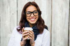 Hipster woman with take-away coffee Royalty Free Stock Images