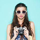 Hipster woman taking photos with retro film camera Royalty Free Stock Images