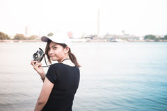 Hipster woman taking photos with retro film camera ,Girl Adventu Stock Photo