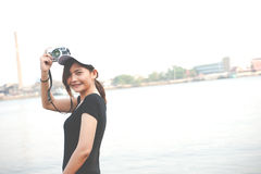 Hipster woman taking photos with retro film camera ,Girl Adventu Stock Photography
