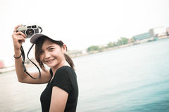 Hipster woman taking photos with retro film camera ,Girl Adventu Royalty Free Stock Photography
