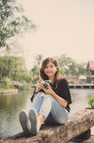 Hipster woman taking photos with retro film camera in outdoor ci Royalty Free Stock Photos