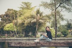Hipster woman taking photos with retro film camera in outdoor ci Royalty Free Stock Image
