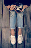Hipster woman taking photos with retro film camera  on wooden floorof city park,beautiful girl photographed in the old camera Stock Photography