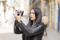 Hipster woman taking pictures with classica camera. Stock Photo