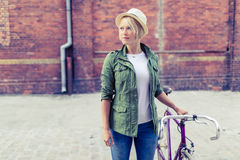 Hipster woman with vintage road bike in city Stock Photos