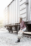 Hipster woman waiting train on railway station. Hipster young girl waiting train on railway background and vintage tone, concept travel and leisure Royalty Free Stock Image