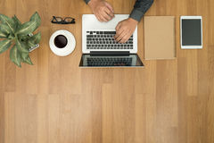 Hipster wooden desktop with laptop, office accessories, flat lay Stock Image
