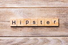 Hipster word written on wood block. Hipster text on wooden table for your desing, concept royalty free stock photography