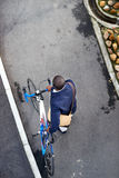 Hipster work commute. Young trendy black african hipster man with bicycle walking in urban city on way commute to work Stock Photography