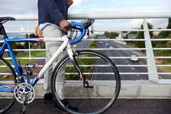Hipster work commute. Young trendy black african hipster man with bicycle walking in urban city on way commute to work Stock Photos
