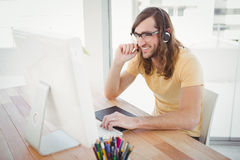 Hipster working at computer desk Stock Images