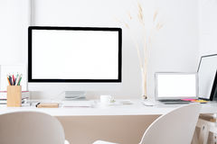 Hipster workplace with white devices Stock Photo