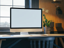 Hipster workspace with computer on table at home or studio. Dark interior  big windows. Loft modern style. 3d rendering Stock Image