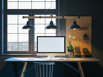 Hipster workspace with computer on table at home or studio. Dark interior  big windows. Loft modern style. 3d rendering Royalty Free Stock Photo
