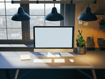 Hipster workspace with computer on table at home or studio. Dark interior  big windows. Loft modern style. 3d rendering Royalty Free Stock Photos