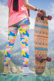 Hipster young and beautiful girl with longboard skateboard at mountain Stock Photos
