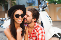 Hipster young couple traveling with vintage scooter Royalty Free Stock Images