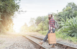 Hipster young girl with backpack walk on railway Stock Photo