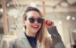 Hipster young girl choosing sunglasses Stock Photo