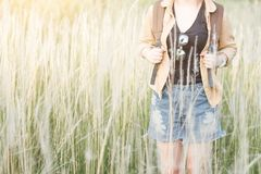 Hipster young girl jump with backpack hiking in forest., relax time and enjoying nature around. Royalty Free Stock Image