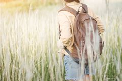 Hipster young girl jump with backpack hiking in forest., relax time and enjoying nature around. Stock Photography
