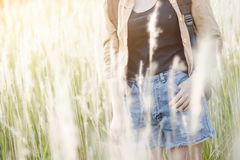 Hipster young girl jump with backpack hiking in forest., relax time and enjoying nature around. Stock Photos