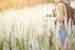 Hipster young girl jump with backpack hiking in forest., relax time and enjoying nature around. Young girl jump with backpack hiking in forest., relax time and Royalty Free Stock Photo
