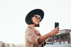 Free Hipster Young Girl Makes Selfie On Phone Stock Image - 109255141