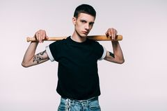 Hipster young guy holding baseball bat on shoulders stock photos
