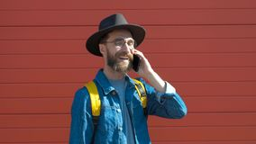 Hipster young man talking on the phone in a urban background. stock video