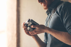 Hipster young man with vintage camera Stock Images
