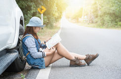 Hipster young woman looking for way during her road-trip. Stock Photos