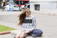 Hipster young woman traveling and taking notes in the stret. Stock Photography