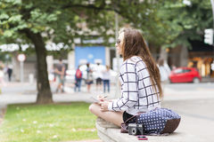 Hipster young woman traveling and taking notes in the stret. Royalty Free Stock Photo