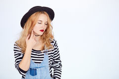 Hipster young woman in trendy clothes dreaming Stock Photography