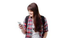 Hipster young woman waiting for someone and using smartphone on white background. Travel vacation getaway trip concept. Hipster young woman communicates via a Royalty Free Stock Photography