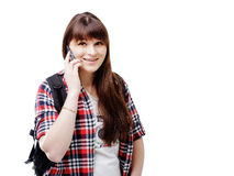 Hipster young woman waiting for someone and using smartphone on white background. Travel vacation getaway trip concept. Hipster young woman communicates via a Stock Images
