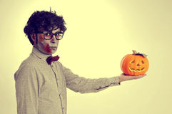 Hipster zombie with a jack-o-lantern, with a retro effect Royalty Free Stock Images
