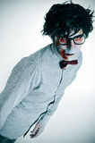 Hipster zombie. Portrait of a hipster zombie wearing shirt, bow tie and black plastic-rimmed eyeglasses Royalty Free Stock Photo
